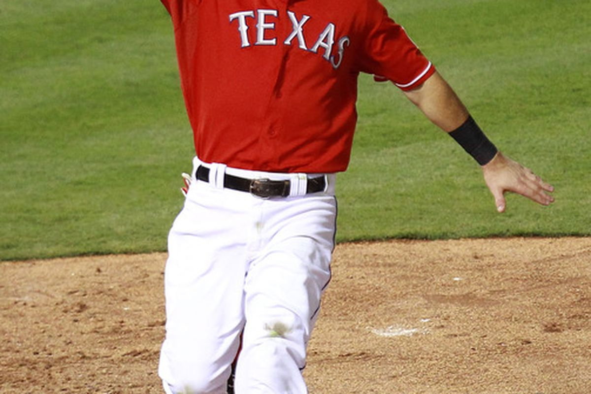 ARLINGTON, TX - AUGUST 09:  Ian Kinsler #5 of the Texas Rangers celebrates the game winning run against the Seattle Mariners at Rangers Ballpark in Arlington on August 9, 2011 in Arlington, Texas.  (Photo by Ronald Martinez/Getty Images)