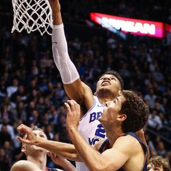 Brigham Young Cougars forward Yoeli Childs (23) takes a shot in the overtime period over Saint Mary's center Evan Fitzner (21) as the BYU Cougars take on the Saint Mary's Gaels in the Marriott Center in Provo on Saturday, Dec. 30, 2017.