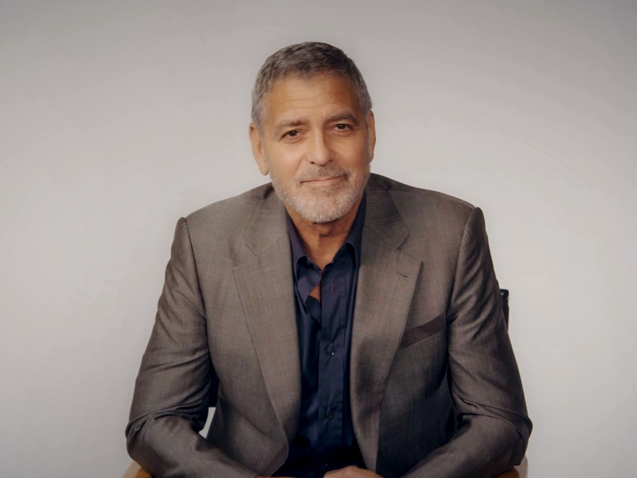 George Clooney says he cuts his own hair with a Flowbee