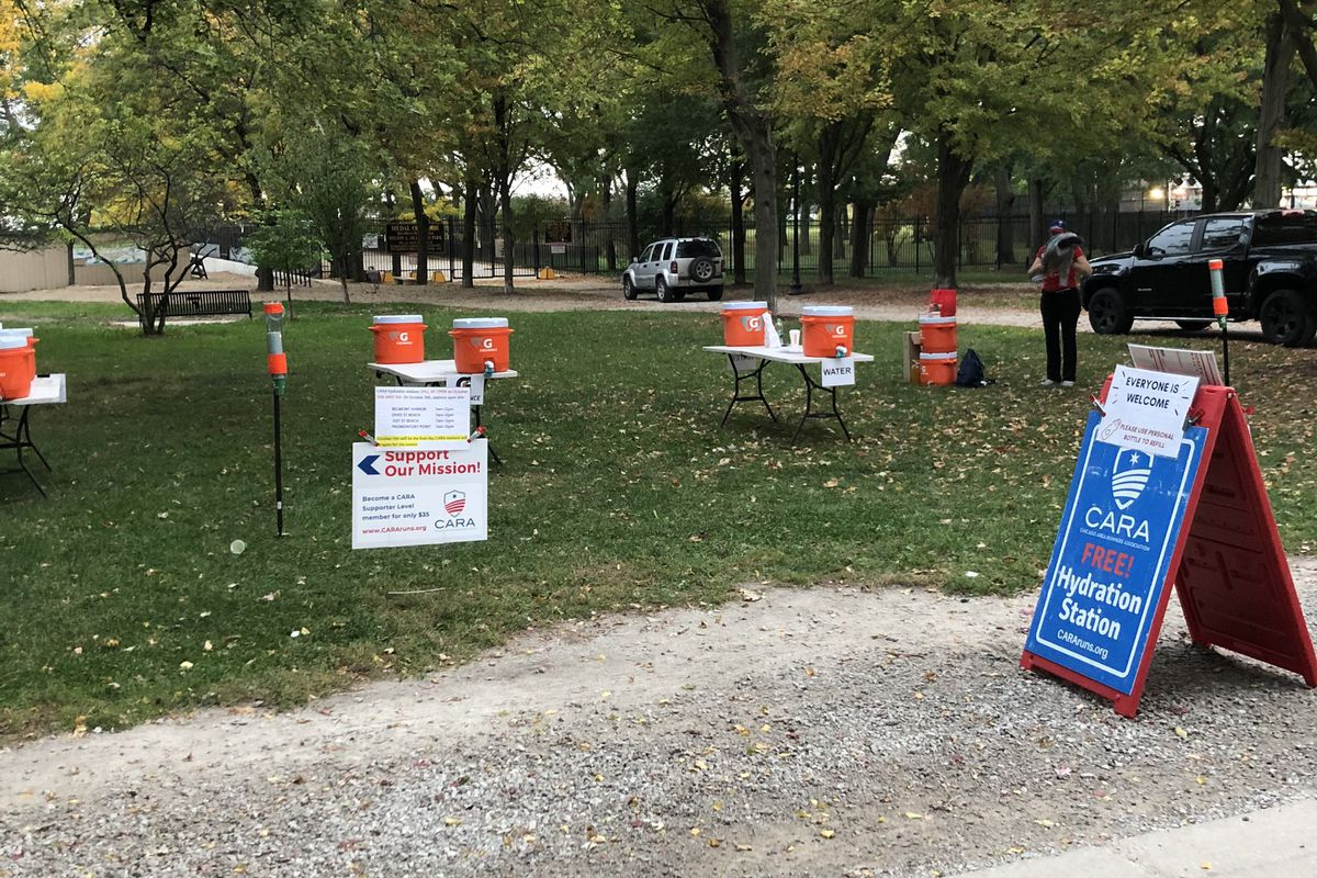 Hydration station set up by the Chicago Area Runners Association for local runners participating in the virtual Chicago Marathon on Sunday, Oct. 11, 2020.
