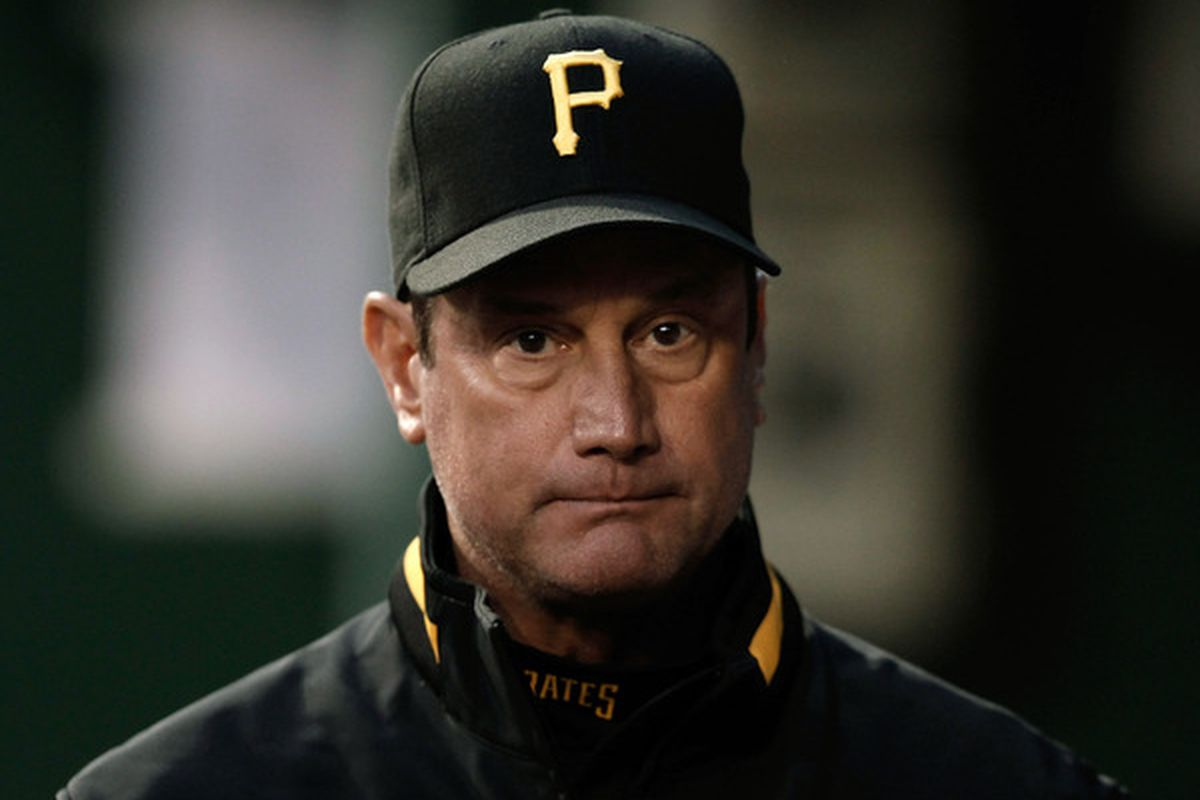 PITTSBURGH - APRIL 20:  Manager John Russell #7 of the Pittsburgh Pirates walks through the dugout during the game against the Milwaukee Brewers on April 20, 2010 at PNC Park in Pittsburgh, Pennsylvania.  (Photo by Jared Wickerham/Getty Images)