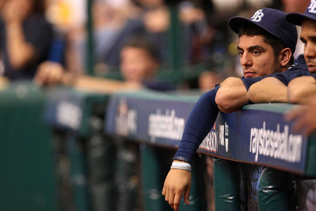 ST PETERSBURG FL - OCTOBER 07:  Matt Garza #22 the Tampa Bay Rays waits in the dugout during Game 2 of the ALDS against the Texas Rangers at Tropicana Field on October 7 2010 in St. Petersburg Florida.  (Photo by Mike Ehrmann/Getty Images)