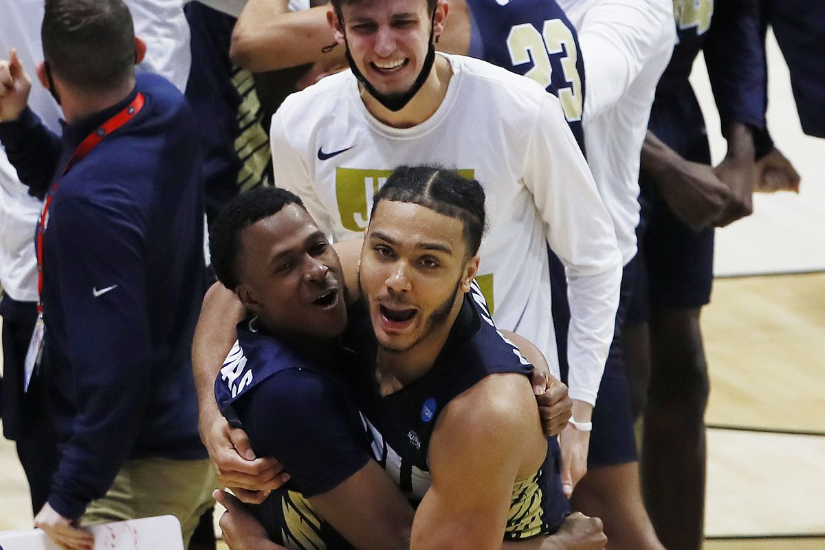 Oral Roberts Golden Eagles guard Max Abmas (left) and forward Kevin Obanor (right) celebrate after an overtime victory against the Ohio State Buckeyes in the first round of the 2021 NCAA Tournament at Mackey Arena.