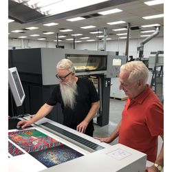 Rob at Stoughton Printing checking the colors for the box