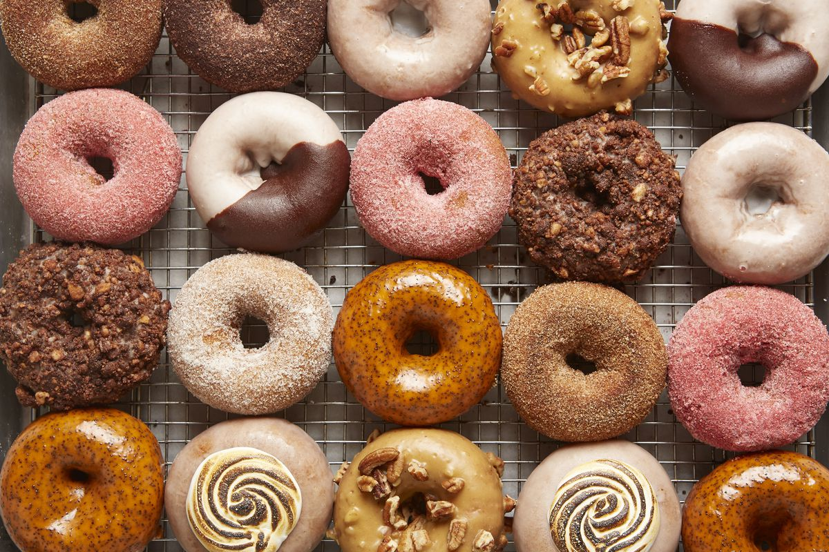 overhead shot of rows of doughnuts in browns and pinks