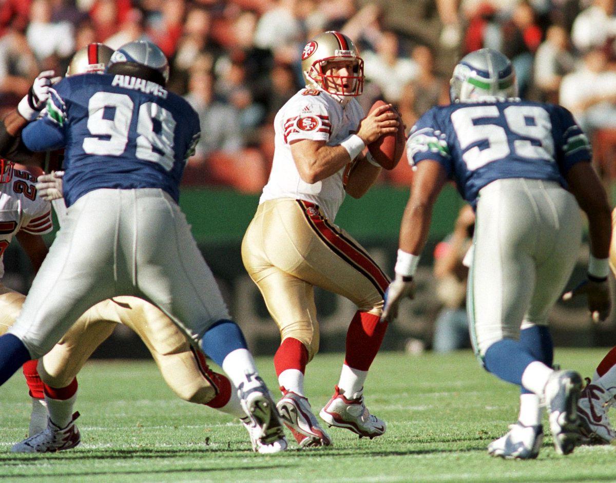 San Francisco 49ers quarterback Steve Young (C) dr