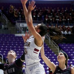 Cedar's Jaidi Willden (34) goes for the basket against Pine View's forward Averi Papa (20) and guard Mady Jensen (3) during the 4A girls championship basketball game at the Dee Events Center in Ogden on Saturday, Feb. 29, 2020.
