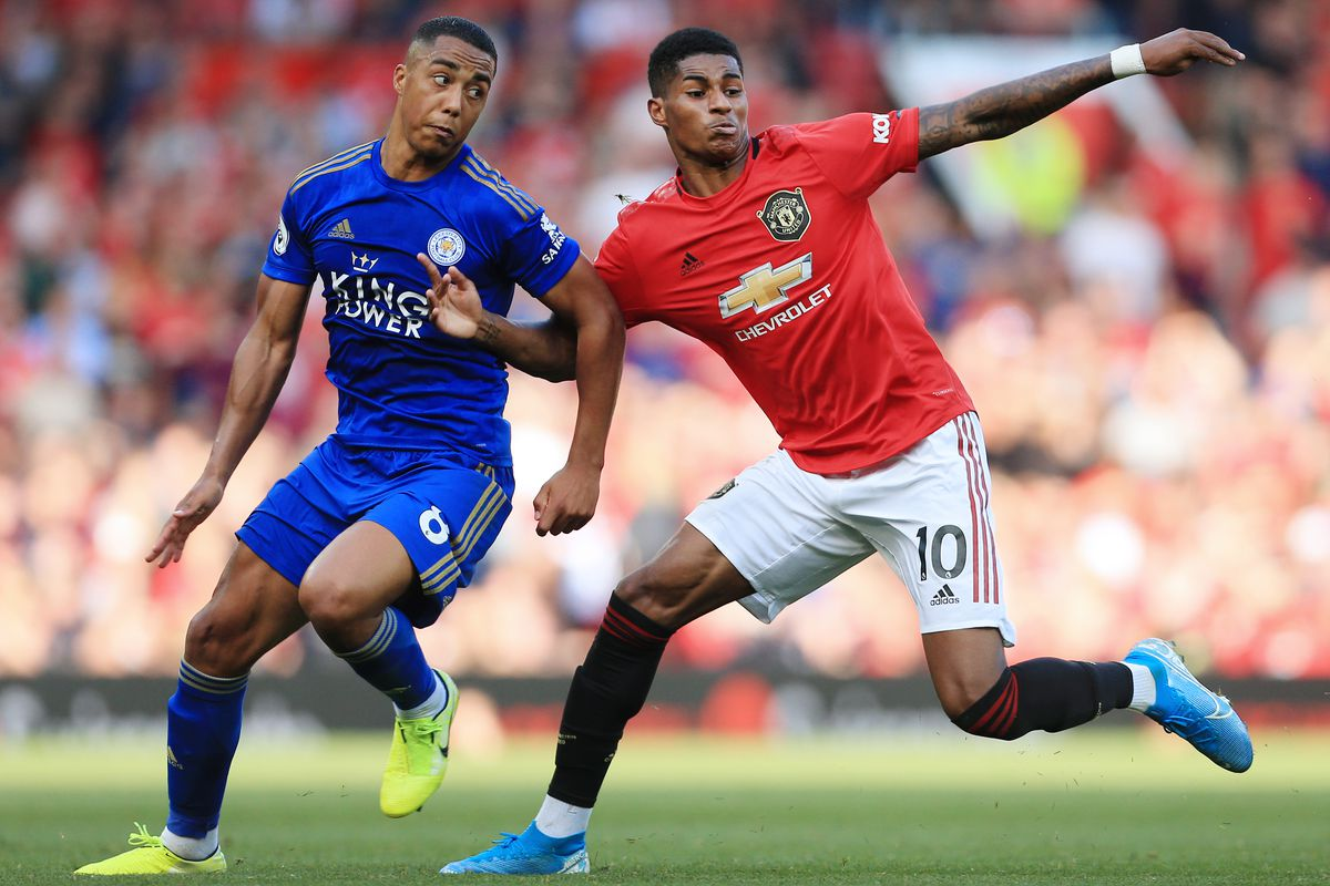 Youri Tielemans battles with Marcus Rashford - Manchester United v Leicester City - Premier League