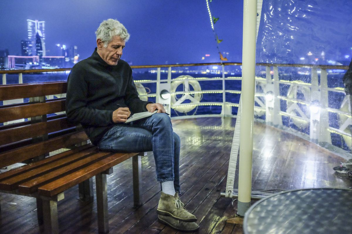 Anthony Bourdain riding a ferry in the Parts Unknown Hong Kong episode