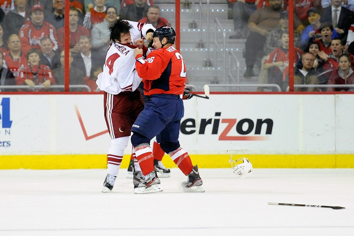 Matt Hendricks #26 of the Washington Capitals fights with Kyle Chipchura #24 of the Phoenix Coyotes at the Verizon Center on November 21, 2011 in Washington, DC.  (Photo by Greg Fiume/Getty Images)