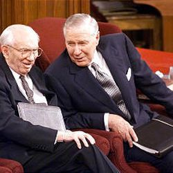 President Gordon B. Hinckley and Second Counselor James E. Faust converse before a Sunday afternoon session general conference.
