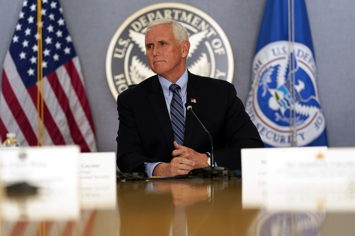 Vice President Mike Pence listens during a briefing about the upcoming presidential inauguration of President-elect Joe Biden and Vice President-elect Kamala Harris, at FEMA headquarters, Thursday, Jan. 14, 2021, in Washington.