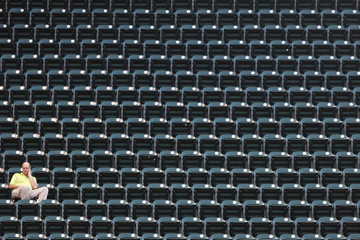 Houston, TX, USA; A fan watches a game between the Houston Astros and the Chicago Cubs at Minute Maid Park. Credit: Troy Taormina-US PRESSWIRE