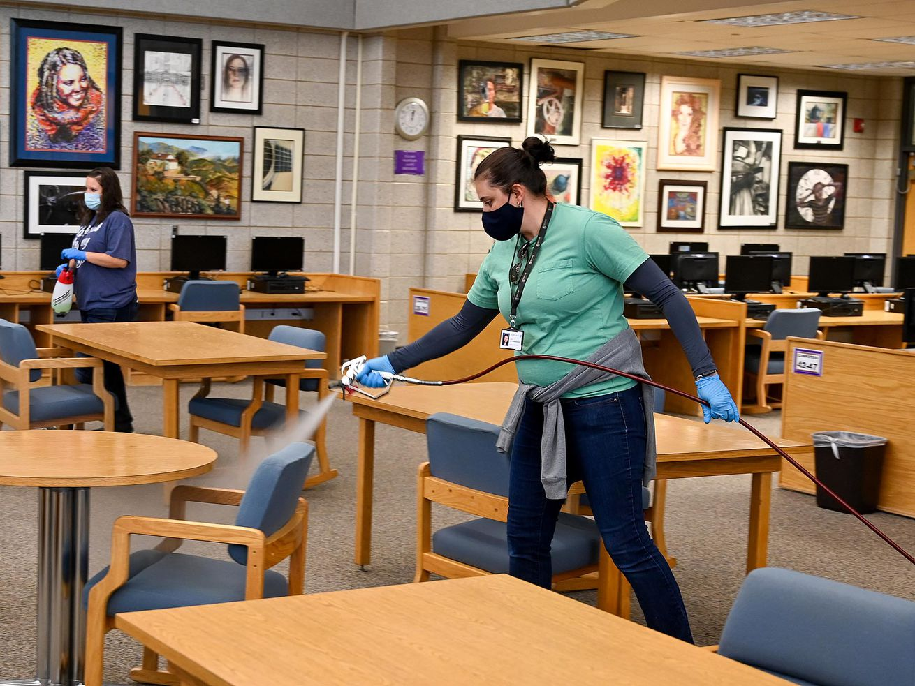 Riverton High School cleaning crews spray tables and chairs in an effort to battle the coronavirus pandemic on Sept. 17, 2020.