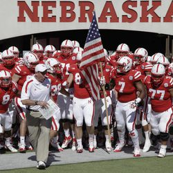 Nebraska's head coach Bo Pelini leads his squad onto the playing field prior to their NCAA college football game against Arkansas State in Lincoln, Neb., Saturday, Sept. 15, 2012.