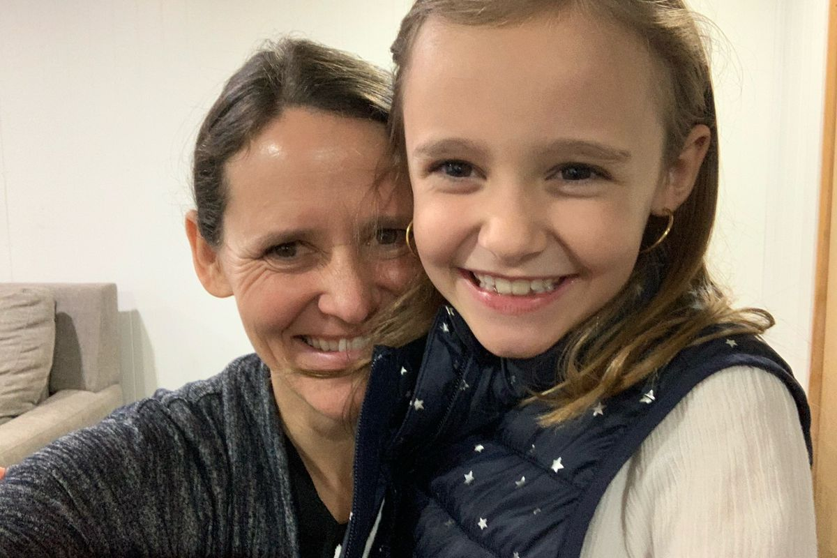 Mother Amy Janssens smiles with daughter Maeve, 8.