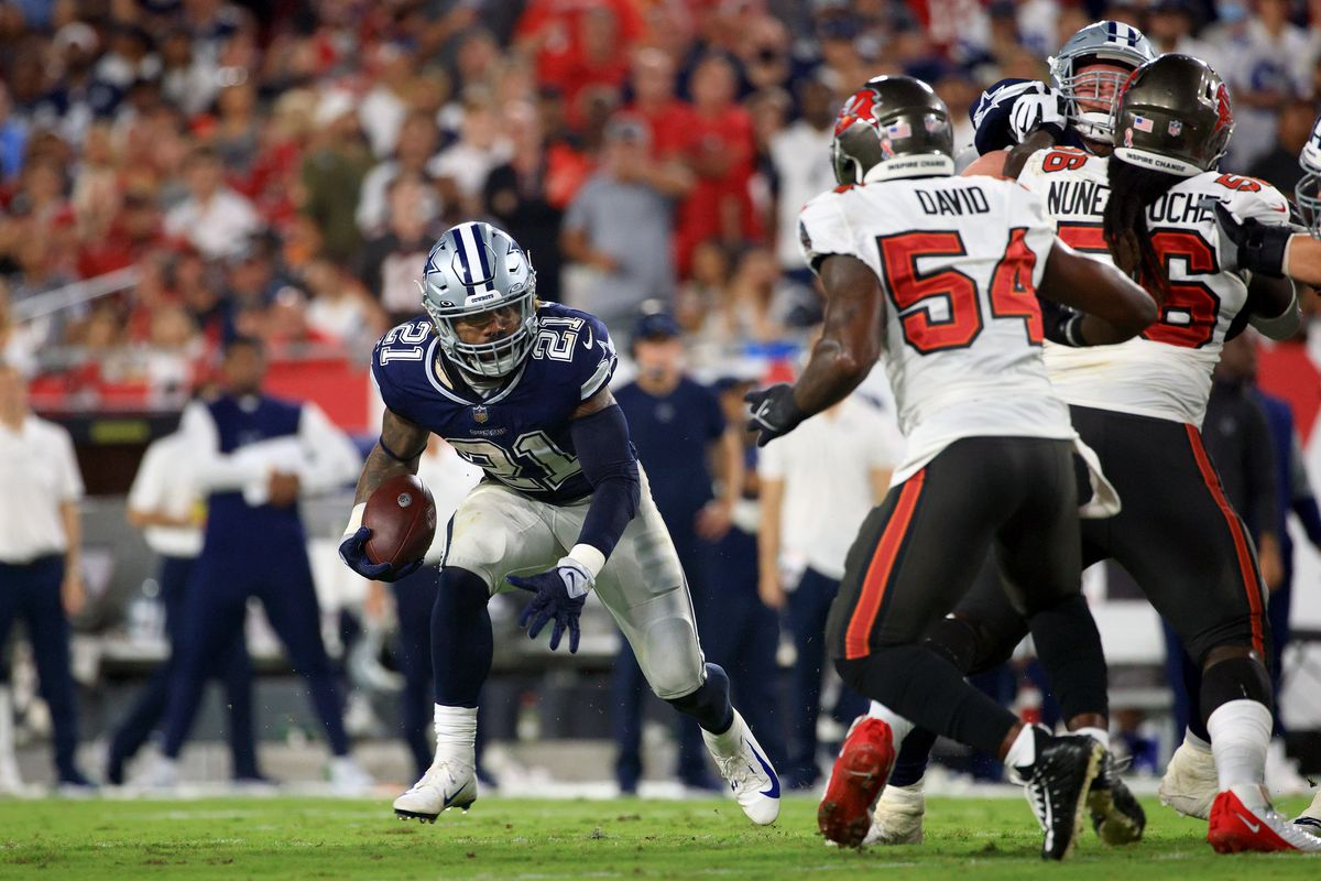 Ezekiel Elliott #21 of the Dallas Cowboys carries the ball during the second quarter against the Tampa Bay Buccaneers at Raymond James Stadium on September 09, 2021 in Tampa, Florida.