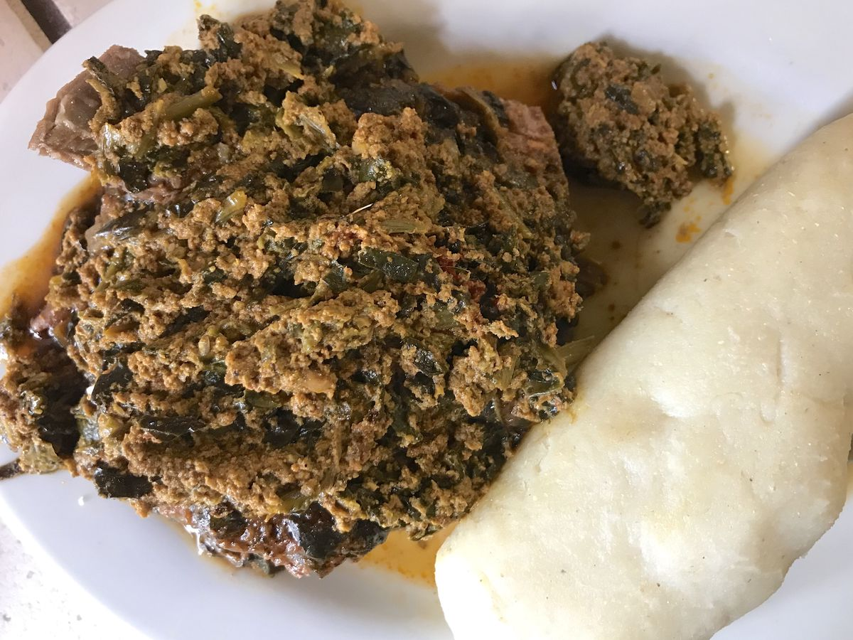 African melon seed–spinach stew with lamb and  fermented cornmeal dough