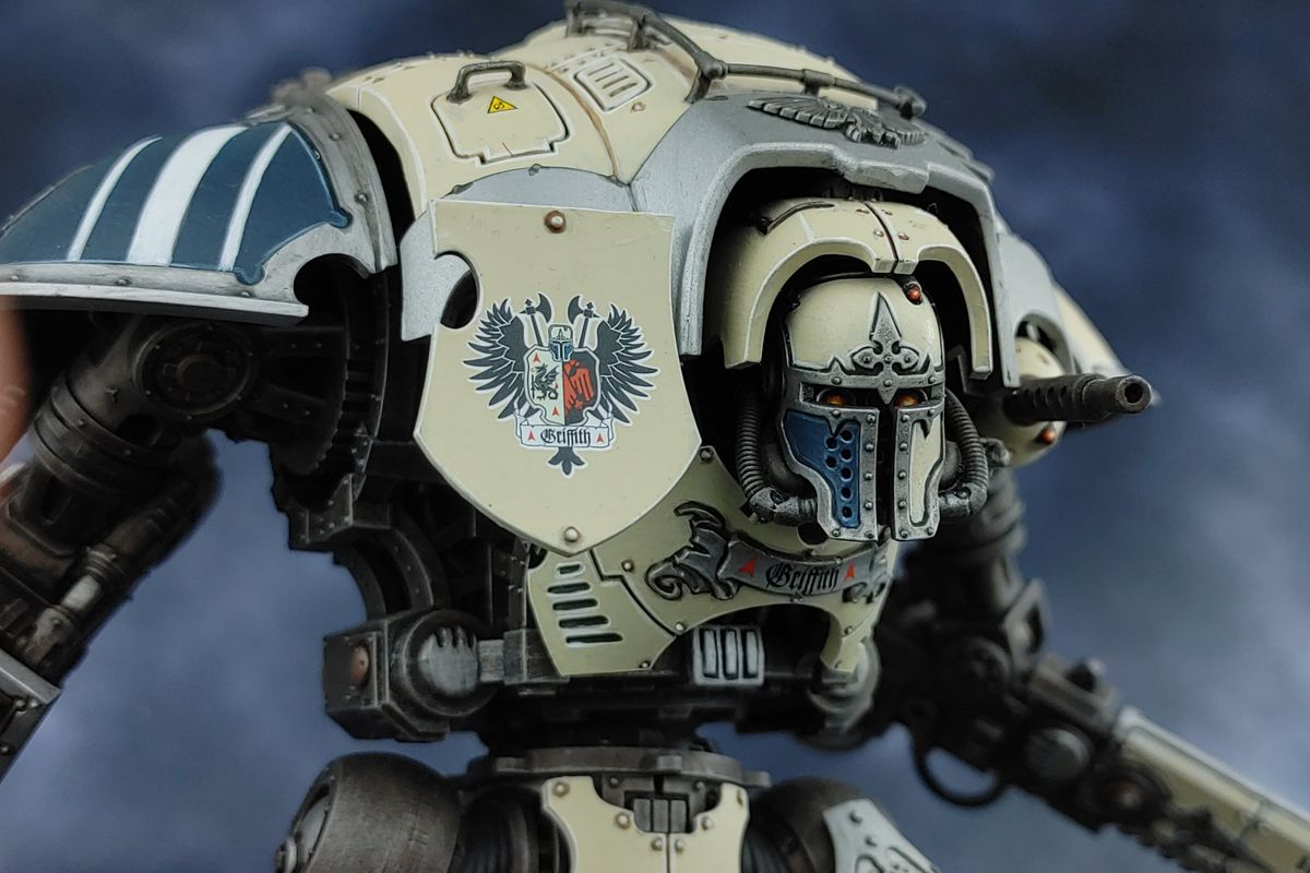 A massive miniature mech stands staring out of the frame
