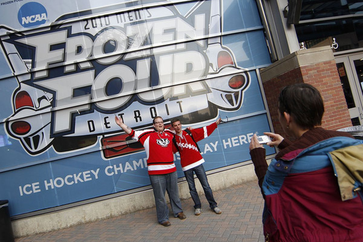 Fans of the Wisconsin Badgers take photos outside Ford Filed prior to playing Boston College in the championship game of the 2010 NCAA Frozen Four on April 10, 2010 at Ford Field in Detroit, Michigan.  (Photo by Gregory Shamus/Getty Images)