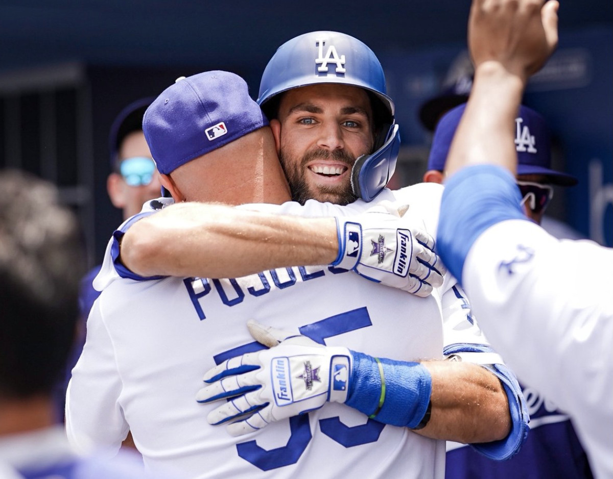 Chris Taylor receives a bear hug from Dodgers teammate Albert Pujols after hitting a home run on Sunday, July 25, 2021 against the Rockies.
