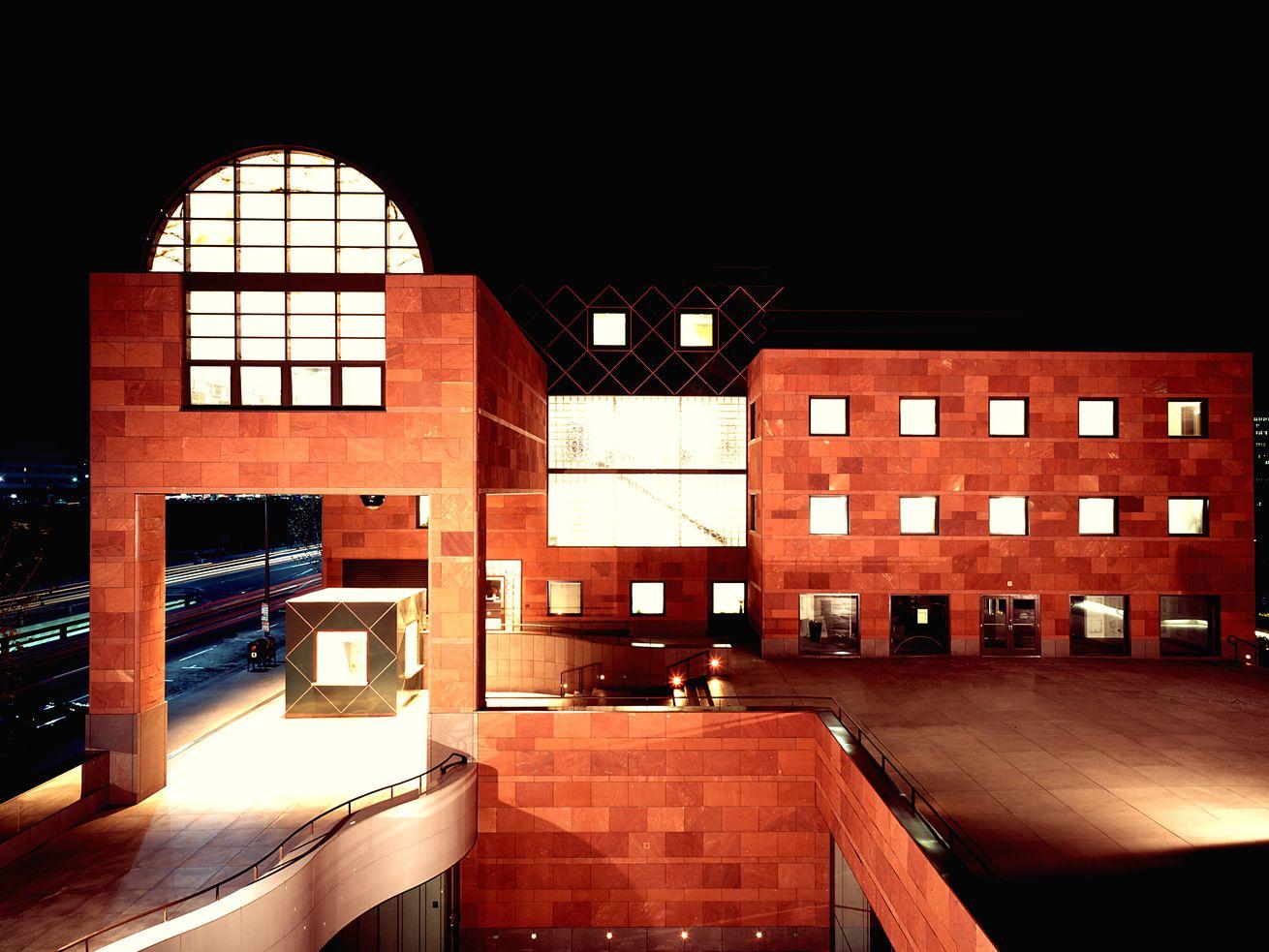 MOCA's glowing geometric forms illuminate Bunker Hill at night.