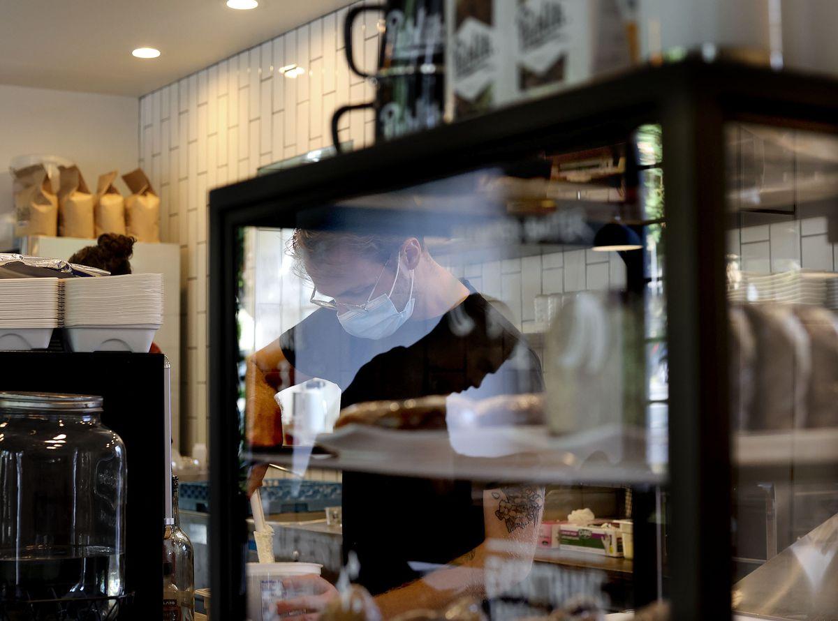 Spencer Turner works at Publik Coffee Roasters in Salt Lake City on Friday, Aug. 20, 2021.