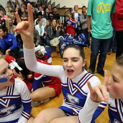 From left, Fremont High School cheerleaders Kennedee Hansen, Kennedy Hansen and Kendee Sanders cheer for teammates in the jump competition at the state championships at Juan Diego Catholic High School in Draper on Saturday, Feb. 15, 2014. In June 2013, when Kennedy Hansen was 15 years old, she was diagnosed with juvenile Batten disease, a rare disorder that generally doesn't manifest itself for the first five to 10 years of a child's life. She died a year later.