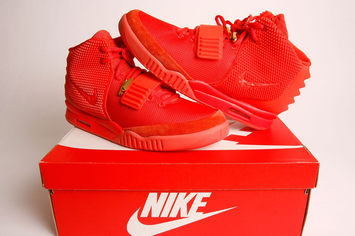 "huge selection of 98879 85a9e The Nike Air Yeezy 2 ""Red October"" sneaker sitting atop a Nike shoebox."