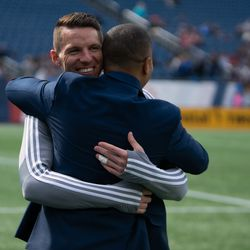 FOXBOROUGH, MA - MARCH 30: Minnesota United FC goalkeeper Bobby Shuttleworth #33 hugs his former teammate Charlie Davies during half time at Gillette Stadium on March 30, 2019 in Foxborough, Massachusetts. (Photo by J. Alexander Dolan - The Bent Musket)