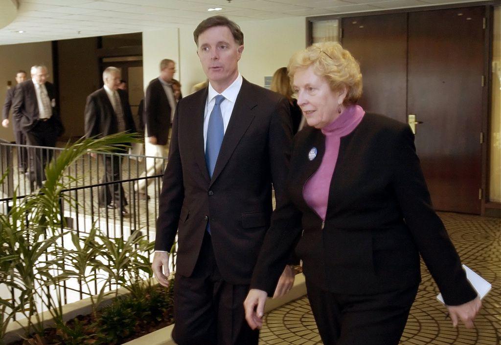 Dan Hynes, left, then a Democratic for U.S. Senate in Illinois, walks with Margaret Blackshere.