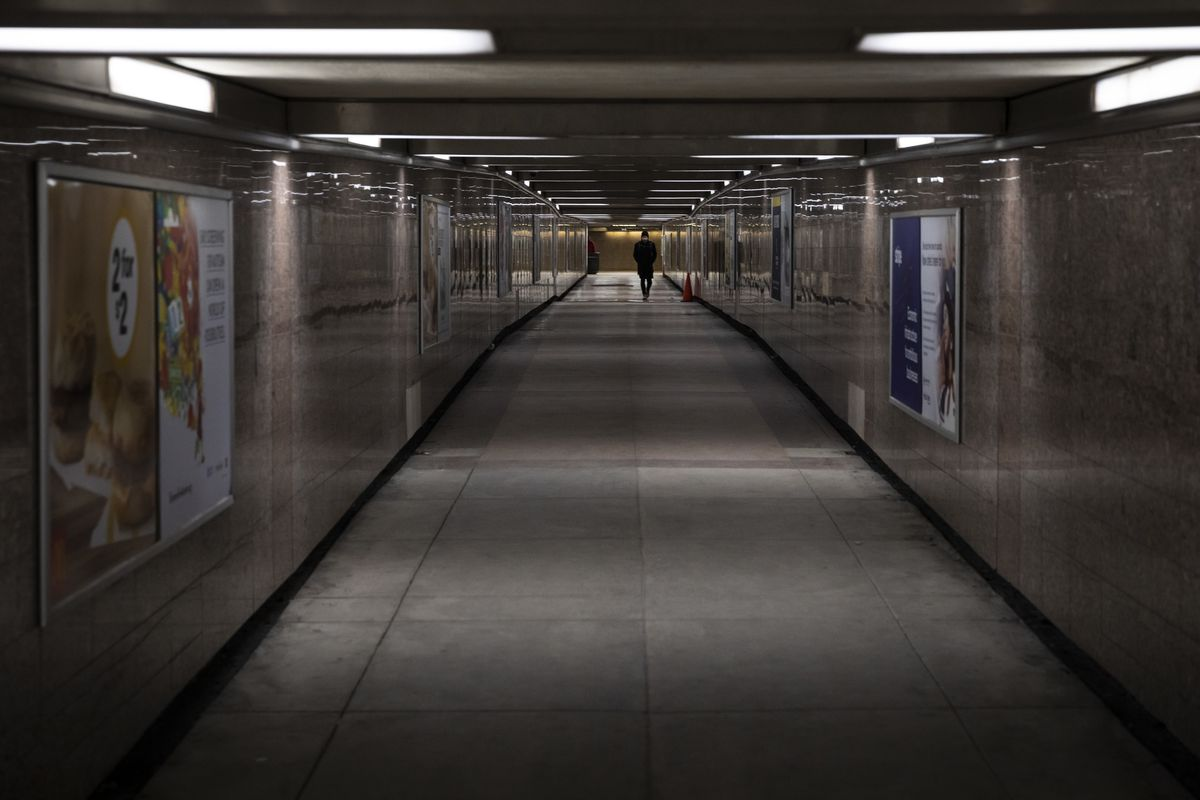People walk in the underground pedestrian tunnel that connects the Jackson Red and Blue lines in the 200 block of South Dearborn, Monday morning, Feb. 17, 2020. A man was killed and two other people were wounded in a shooting in the tunnel early Monday.