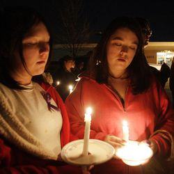 Shayanna and Stephanie  Smith along with Powell family friends and well wishers hold a candlelight vigil in Salt Lake County  Sunday, Feb. 5, 2012. Josh Powell and his two sons were killed in an explosion in Washington.