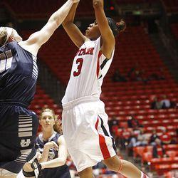 Utah's Iwalani Rodrigues, right, puts up a shot over Utah State's Jenna Johnson as Utah and Utah State play , in the Huntsman Center. Utah won 92-64.