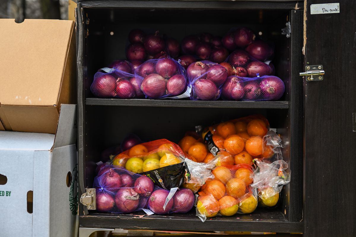 Volunteers filled a pantry with fresh produce next to an East Village community fridge, Dec. 12, 2020.