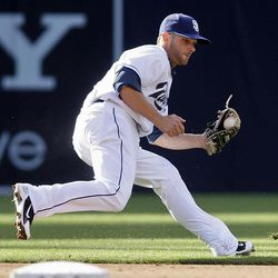 San Diego Padres shortstop Andy Parrino goes behind second base to haul in a sharp ground ball hit by Arizona Diamondbacks' Aaron Hill in the fifth inning of a baseball game on Wednesday, April 11, 2012 in San Diego.