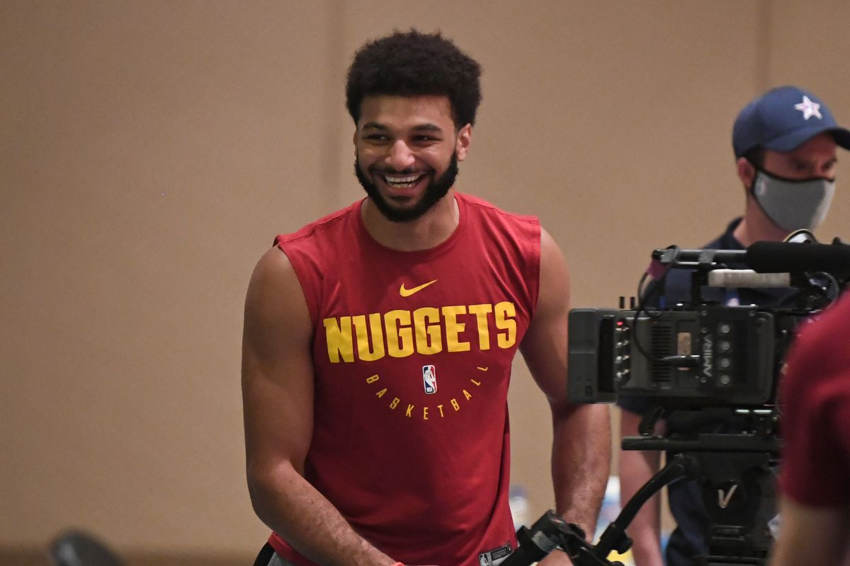 Jamal Murray of the Denver Nuggets smiles during practice as part of the NBA Restart 2020 on July 29, 2020 in Orlando, Florida.