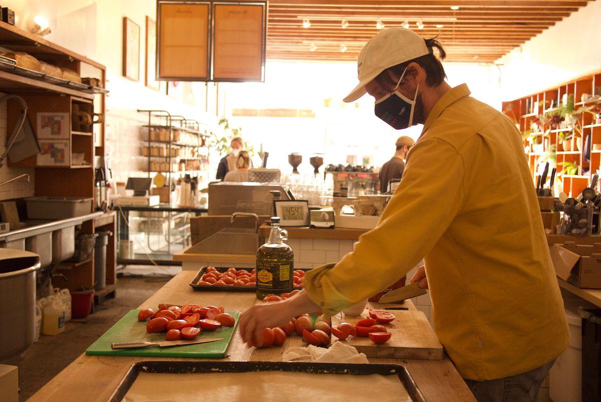 John Shaver preps vegetables in a restaurant kitchen.