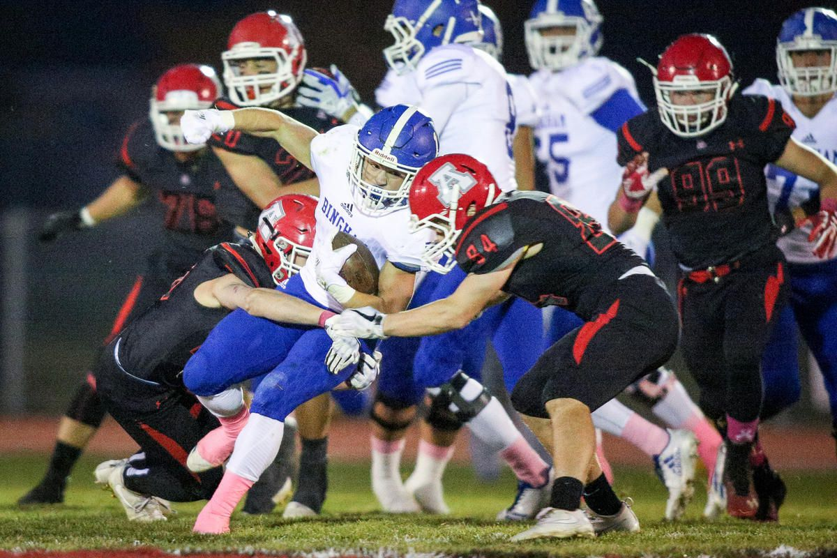 Bigham's Braedon Wissler (1) is tackled by American Fork's Brock Hughes (26) and Mason Bergman (84) as American Fork High takes on Bingham High in American Fork on Friday, Oct. 13, 2017. Bingham High wins the game 48 - 21.