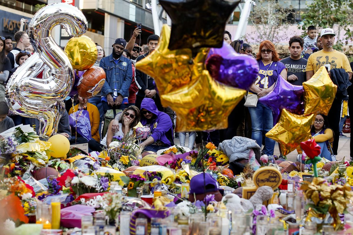 Fans pay respect at a memorial for Kobe Bryant near the Staples Center in Los Angeles. Bryant, the 18-time NBA All-Star who won five championships and became one of the greatest basketball players of his generation during a 20-year career with the Los Angeles Lakers, died in a helicopter crash in January.