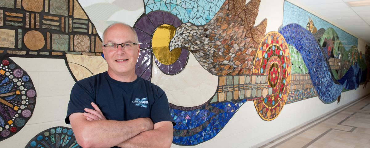 Art teacher Jeriel McGinness has overseen the creation of mosaics like this one at Creekside Middle School in Woodstock.