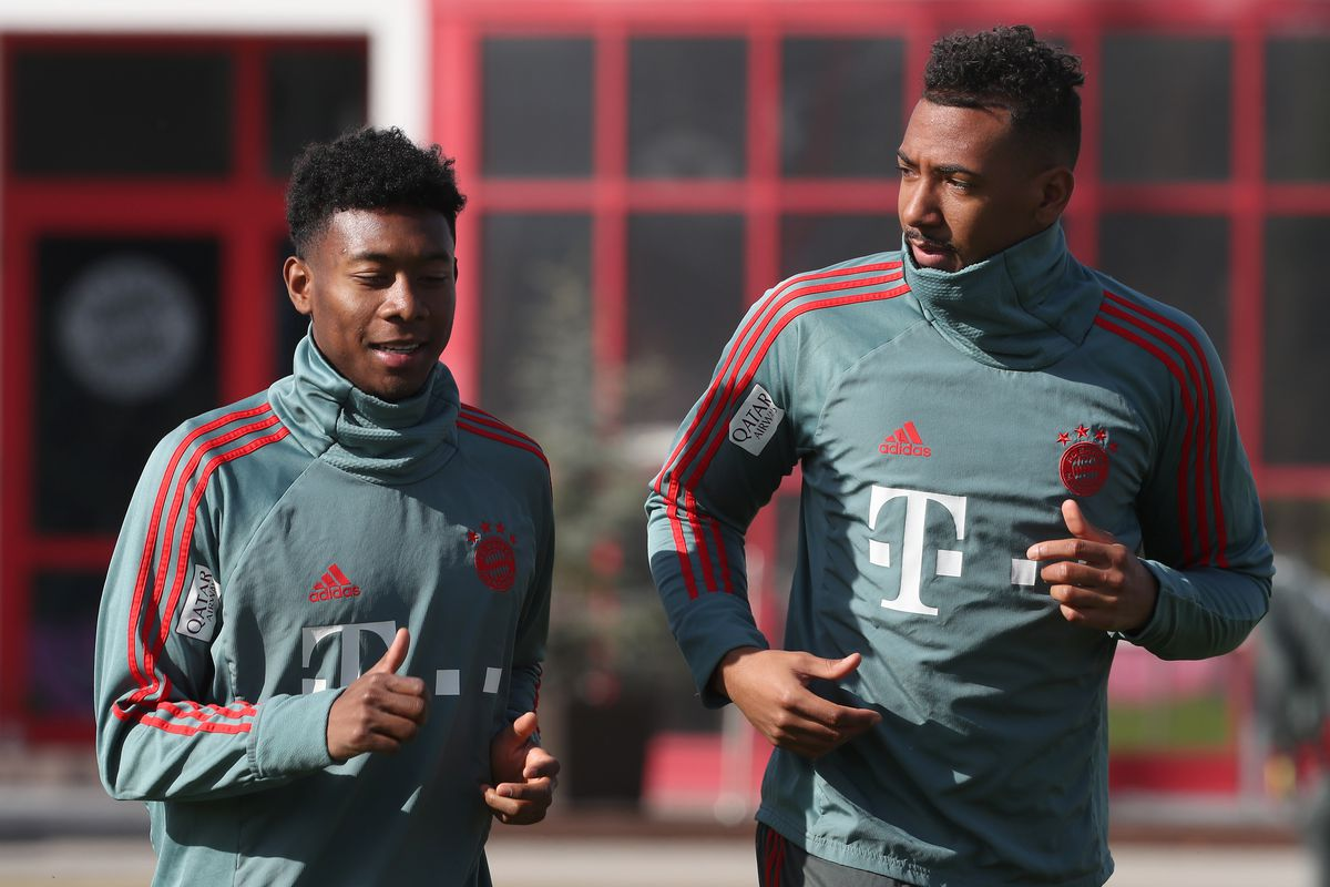 MUNICH, GERMANY - FEBRUARY 26: David Alaba (L) and Jerome Boateng of FC Bayern Muenchen chat during a training session at the club's Saebener Strasse training ground on February 26, 2019 in Munich, Germany.