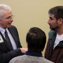 Joe Miner, executive director of the Utah Health Department, left, Andy Borrego, long-term recovery program manager at First Step House, center, and Dan Davidson talk after a press conference at the Capitol in Salt Lake City on Friday, Jan. 29, 2016, where legislators presented a group of bills targeted at the opioid overdose crisis that is sweeping the state. Davidson is a recovering heroin addict, now working as a counselor for others.