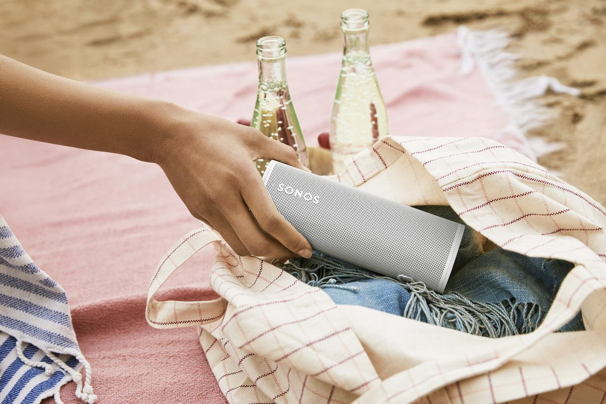 Sonos roam in a tote bag at a picnic on the beach