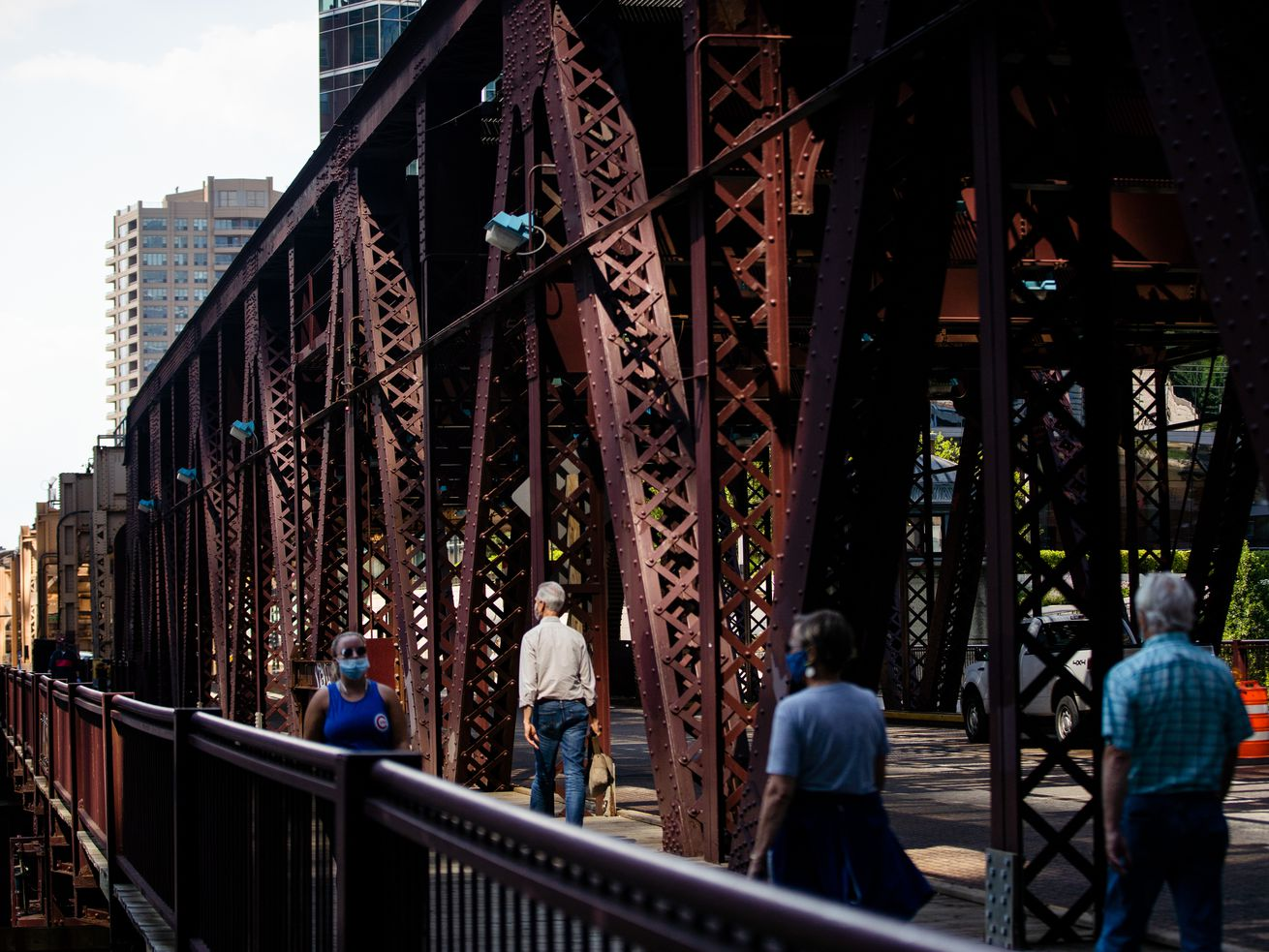 The Lake Street bridge downtown carries cars and pedestrians on one level and CTA trains above.