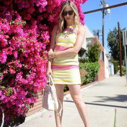 "Emily of <a href=""http://cupcakesandcashmere.com/"">Cupcakes and Cashmere</a> is wearing a <a href=""http://www.loft.com/loft/product/product%3A292176/LOFT-dresses-031813/Corded-Dobby-Stripe-Shift-Dress/292176"">Loft </a>dress, Celine pumps, <a href=""http://"