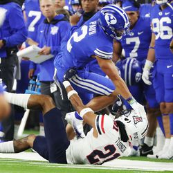 Brigham Young Cougars wide receiver Neil Pau'u (2) pushes down Arizona Wildcats safety Jaxen Turner (21) during the Vegas Kickoff Classic in Las Vegas on Saturday, Sept. 4, 2021.