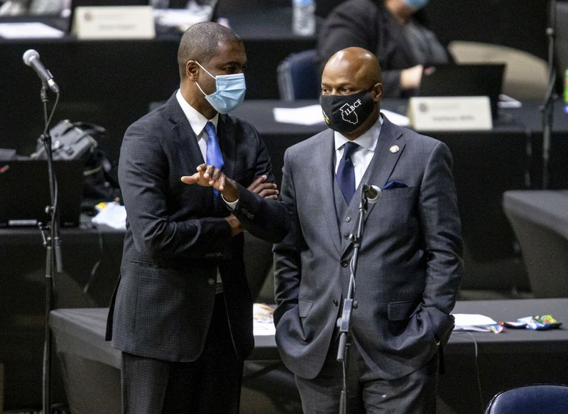 State Rep. La Shawn K. Ford, D-Chicago, left, talks with fellow state Rep. Emanuel Chris Welch, D-Hillside, on Monday.