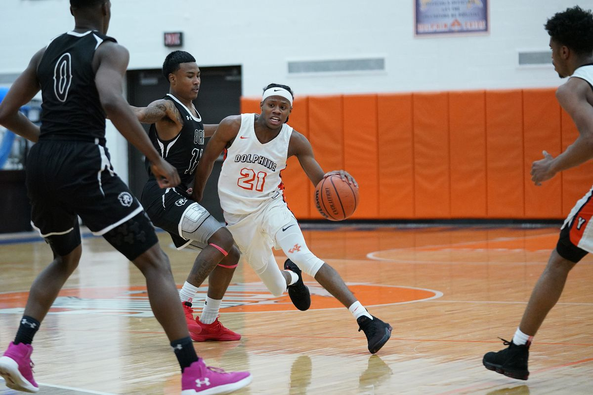 Young's DJ Steward (21) tries to get into the paint against Orr.