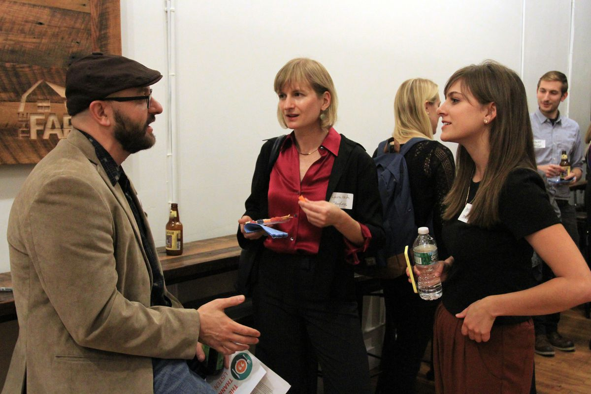 Christian Clarke, an English teacher at Brooklyn Technical High School, speaks with Laura Neish (middle) and Anne Vierse (right) of StoryCorps.